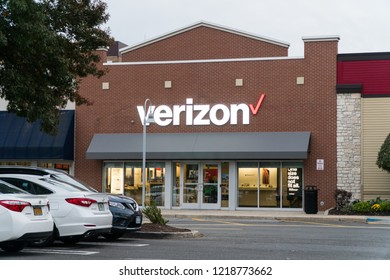 New York, USA - Circa 2018: Verizon wireless store front facade exterior view from parking lot in shopping center