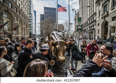 new York, USA - Circa March 2016 - tourists touching the wall street bull