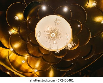 NEW YORK, USA - CIRCA MAY 2017: The gold-leaf-covered domed petal-shaped ceiling and crystal chandeliers of the auditorium inside the Metropolitan Opera House in New York City