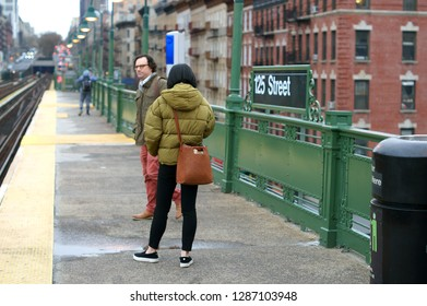 NEW YORK, USA - DEC 15, 2018: 125th Street and passengers. New York City Subway rapid transit station