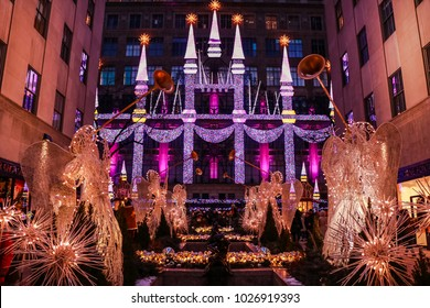 NEW YORK, USA - DEC 30, 2017: Saks 5th Avenue Christmas Light Show and Rockefeller Statue Ornaments