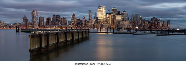 NEW YORK, USA - DECEMBER 04, 2010:  Panorama view of Manhattan skyline across the Hudson River from the waterfront Walkway in Jersey City at dusk