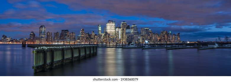 NEW YORK, USA - DECEMBER 04, 2010:  Panorama view of Manhattan skyline across the Hudson River from the waterfront Walkway in Jersey City at night