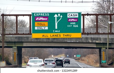 NEW YORK, USA - DECEMBER 14, 2018: EZPass signs and terminal. E ZPass is electronic toll collection system used on tolled roads, tunnels and bridges, and tunnels in the United States