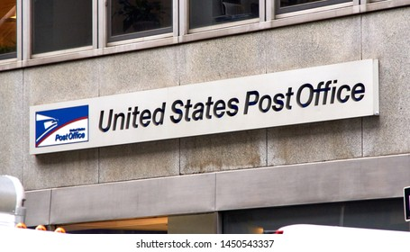 NEW YORK, USA - DECEMBER 14, 2018: Logo and signage of USPS on a wall. United States Postal Service is an independent agenc of US federal government responsible for providing postal service in the US