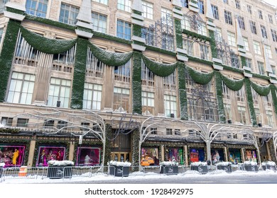 New York, New York USA - December 17 2020: Saks Fifth Avenue with Christmas Decorations and Snow in Midtown Manhattan of New York City