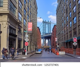 New York, USA, December 25, 2017. View of the Manhattan Bridge, from Washington Street, in the Dumbo area in Brooklyn. This place is visited every day by many tourists.