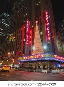 New York, USA, December 27, 2017. Theater, Radio City Music Hall, at night with illuminations and Christmas tree
