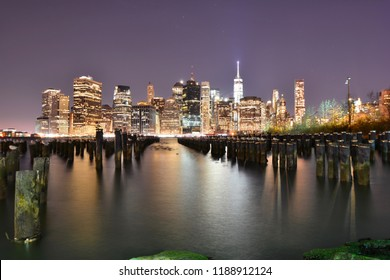 New York, Usa - December 30 2016:  New York City panorama at night with illuminated skyscrapers reflecting on the Bay in the Port of Brooklyn