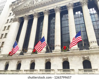 New York, USA - December 30 2015: Exterior of the building of The New york Stock Exchange with American flags in Christmas.