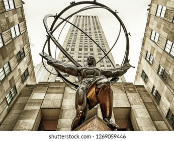 New York, USA, December 6, 2018: Atlas is a bronze statue in front of Rockefeller Center within the International Building's courtyard in Midtown Manhattan, New York City, USA
