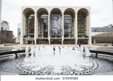New York, New York, USA -  February 10, 2016: The world famous Metropolitan Opera House at Lincoln Center in Manhattan. People can be seen on the plaza around the fountain.