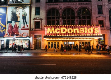 NEW YORK, USA - FEBRUARY 10, 2017: World famous McDonalds fast food chain entrance neon signs along 42nd street in Times Square, New York City, USA.