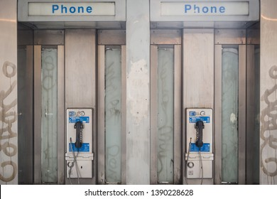 NEW YORK, USA - FEBRUARY 23, 2018: Old phone booths on the streets of Manhattan in New York