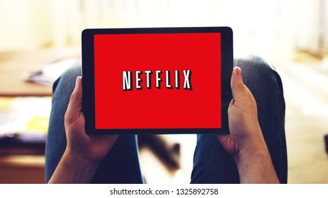 New York, USA - February 28, 2019: netflix app logo on tablet screen, watching series online at home