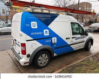 New York, New York / USA - February 6 2020: parked Spectrum van on a rainy day in Queens, NY