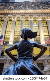 New York, USA - February 9, 2019 - The Fearless Girl statue facing The New York Stock Exchange NYSE building in Lower Manhattan, New York City