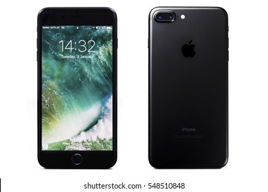 New York, USA - January 03, 2017: Brand new black Apple iPhone 7 Plus front side and backside isolated on background with clipping path.