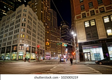 NEW YORK, USA - JANUARY 13, 2018: Intersection of Broadway and 57rd street by night.