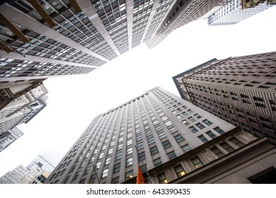 NEW YORK, USA – JANUARY 15 2017: View up to the clear sky in the street packed with skyscrapers.
