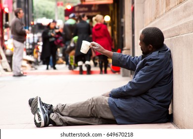 NEW YORK, USA - JANUARY 15 2017: Street portrait of an african american beggar who is sitting on the street asking for change