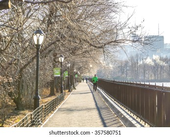 NEW YORK, USA - JANUARY 5, 2015: In New York, Central Park is the place where runners enjoy of their sport. Central Park is an urban park in middle-upper Manhattan, opened in 1857.