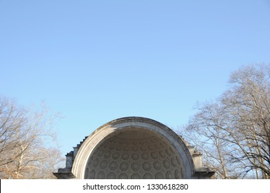 New York, New York / USA - January 9, 2010: Focus on the dome detail of the Naumburg Bandshell set against leafless trees and clear blue sky located at New York City's Central Park.