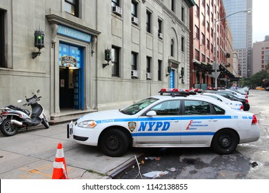 NEW YORK, USA - JULY 1, 2013: Police car at the First Precinct of New York Police Department. NYPD employs 34,500 uniformed officers.