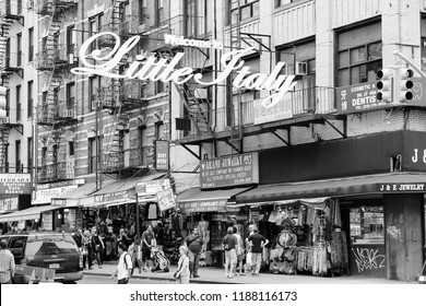 NEW YORK, USA - JULY 1, 2013: People visit Little Italy in New York. Little Italy is a famous Italian community in Manhattan. As many as 10,000 Italians lived there in 1910s.