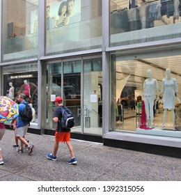 NEW YORK, USA - JULY 1, 2013: People walk by Elie Tahari store in 5th Avenue, New York. Elie Tahari is an Iranian-American fashion designer and his brand brings USD 500 million in annual revenue.