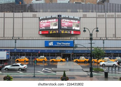 NEW YORK, USA - JULY 1, 2013: People walk by rainy Madison Square Garden in New York. MSG is one of most popular multi-purpose indoor arenas in NY. It dates back to 1964.