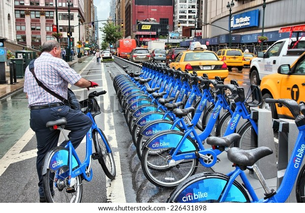 NEW YORK, USA - JULY 1, 2013: Man uses Citibike bicycle sharing station in New York. With 330 stations and 6,000 bicycles it is one of top 10 bike sharing systems in the world.