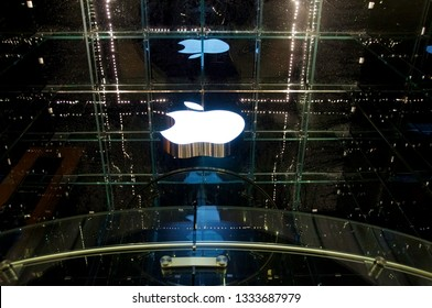 New York, New York / USA - July 13, 2010: A reverse look at the gleaming white Apple logo at night hanging on the glass cube of the 5th Avenue flagship store in New York City.