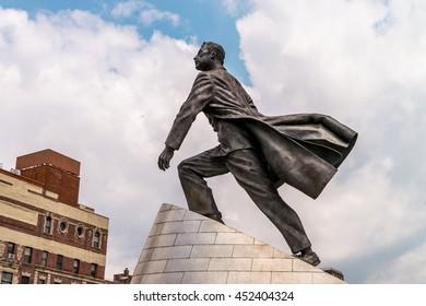 NEW YORK, USA - JULY 13, 2016: Adam Clayton Powell Jr statue on Malcolm X Blvd, Harlem, New York, United States of America