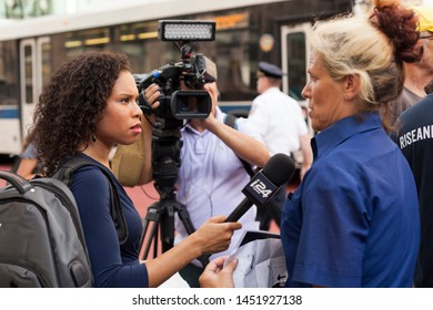 New York, New York, USA - July 15, 2019: A woman is being interviewed for a local televison station.