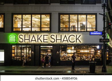 New York, New York, USA - July 15, 2016: Shake Shack near Herald Square in Manhattan. Shake Shack is a trendy food chain known for quality. People can be seen.
