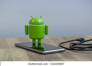 New York, USA - July 2, 2018 - Google Android figure standing on a smart phone