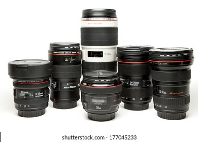 New York, USA - July 2, 2013: Set of Canon EF lenses containing a 8-15mm fish-eye, a 16-35mm, a 50mm, a 100mm Macro lens, a 24-70mm zoom lens and a 70-200mm tele.
