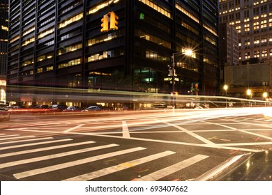 NEW YORK, USA - JULY 2, 2017: Light trail formed by number of car headlight on busy street of Wall Street New York.