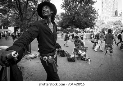 NEW YORK (USA) - JULY 2016:NEW YORK (USA) - JULY 2016: Black and white portrait of a young Afro American guy, resembling  Jimi Hendrix in Union Square.