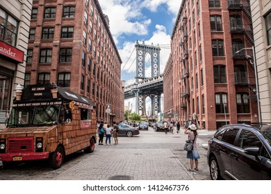 New York / USA - July 2017 , People on the street taking pictures of a famous Manhattan Bridge