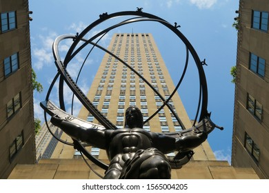New York, USA - July 2019: Atlas statue under the blue sky of the Rockefeller center in Manhattan