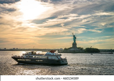 NEW YORK, USA - JULY 26, 2016: People traveling to Statue Of Liberty by local ferry. The Staten Island Ferry is one of the last remaining vestiges of an entire ferry system in New York City