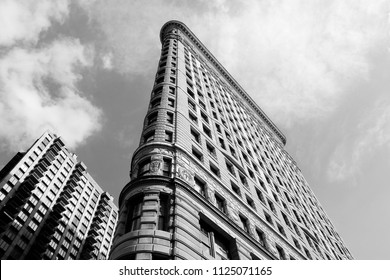 NEW YORK, USA - JULY 3, 2013: Flatiron Building in New York. Flatiron is one of the most recognizable buildings in NY and is considered National Historic Landmark.