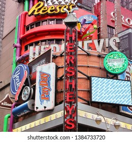 NEW YORK, USA - JULY 3, 2013: Famous Hershey's ad at Times Square in New York. Hershey Company is a chocolate manufacturer founded in 1894. It employs 13,700 people (2010).
