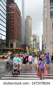 NEW YORK, USA - JULY 3, 2013: People walk along 8th Avenue in Midtown Manhattan. Almost 19 million people live in New York City metropolitan area.