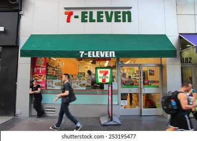 NEW YORK, USA - JULY 3, 2013: People walk past 7-Eleven convenience store in New York. 7-Eleven is world's largest operator, franchisor and licensor of convenience stores, with more than 46,000 shops.
