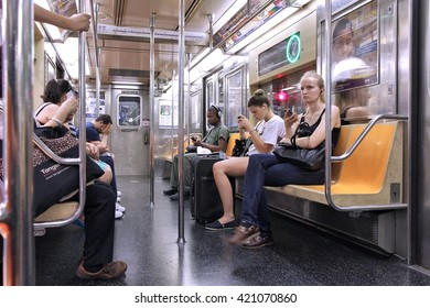 NEW YORK, USA - JULY 3, 2013: People ride Subway train in New York. With 1.67 billion annual rides, New York City Subway is the 7th busiest metro system in the world.