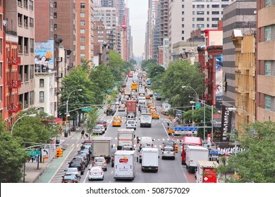 NEW YORK, USA - JULY 3: People drive in heavy traffic along 1st Avenue in New York. New York is among most congested cities in America. In 2009 average American spent 34 hours in traffic jams.
