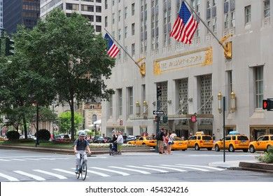 NEW YORK, USA - JULY 4, 2013: People visit The Waldorf-Astoria hotel in New York. Waldorf Astoria is part of Hilton Worldwide, the group that manages 4,660 locations.